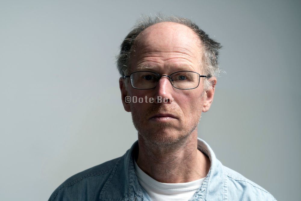 portrait of a 50+ years balding male person