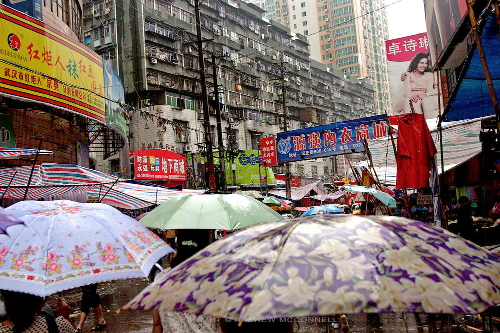 Rain lashes the narrow streets of Wuhan.,