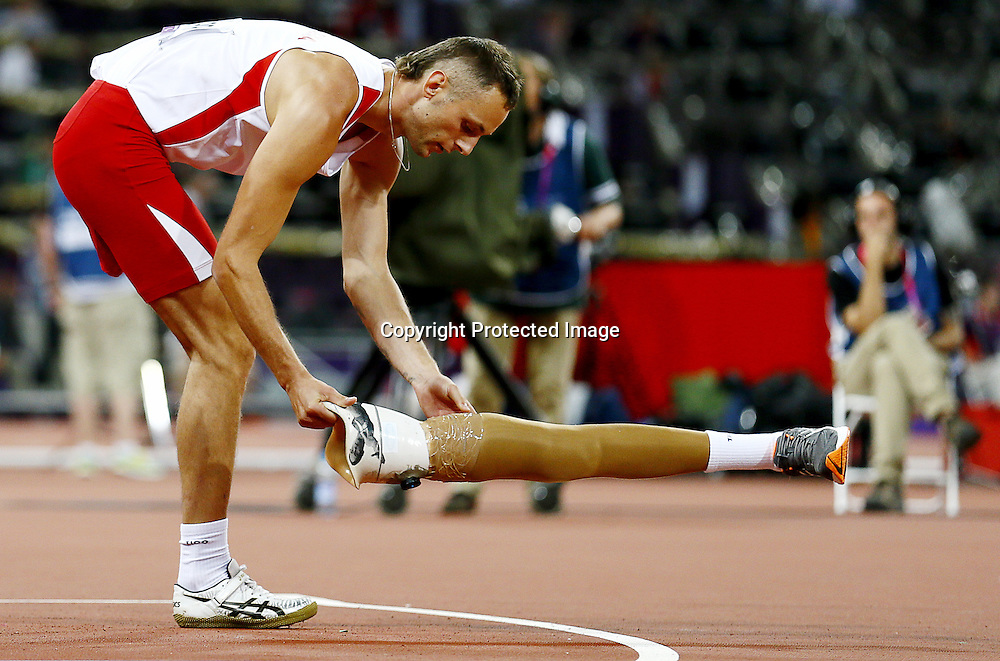 Lukasz Mamczarz of Poland prepares to compete in Men's High Jump - F42 Final at Olympic Stadium during the London 2012 Paralympic Games in London, Britain, 03 September 2012.  EPA/KERIM OKTEN