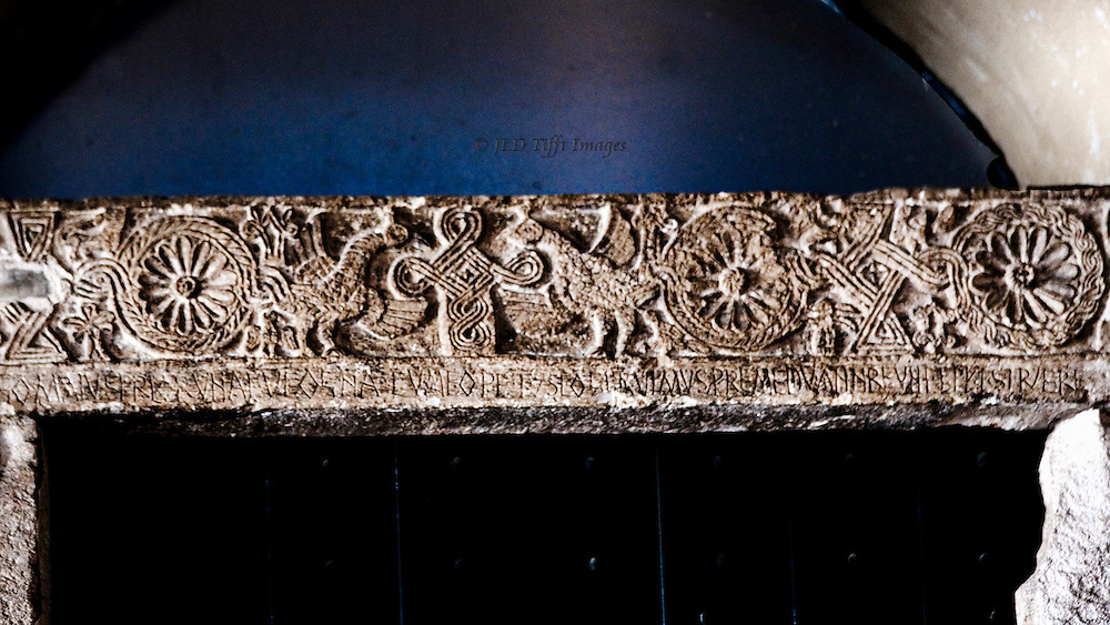 Trogir: door lintel over entrance to church of St. Barbara, 11th century.  Motifs include rosettes, interlace, and animals in profile
