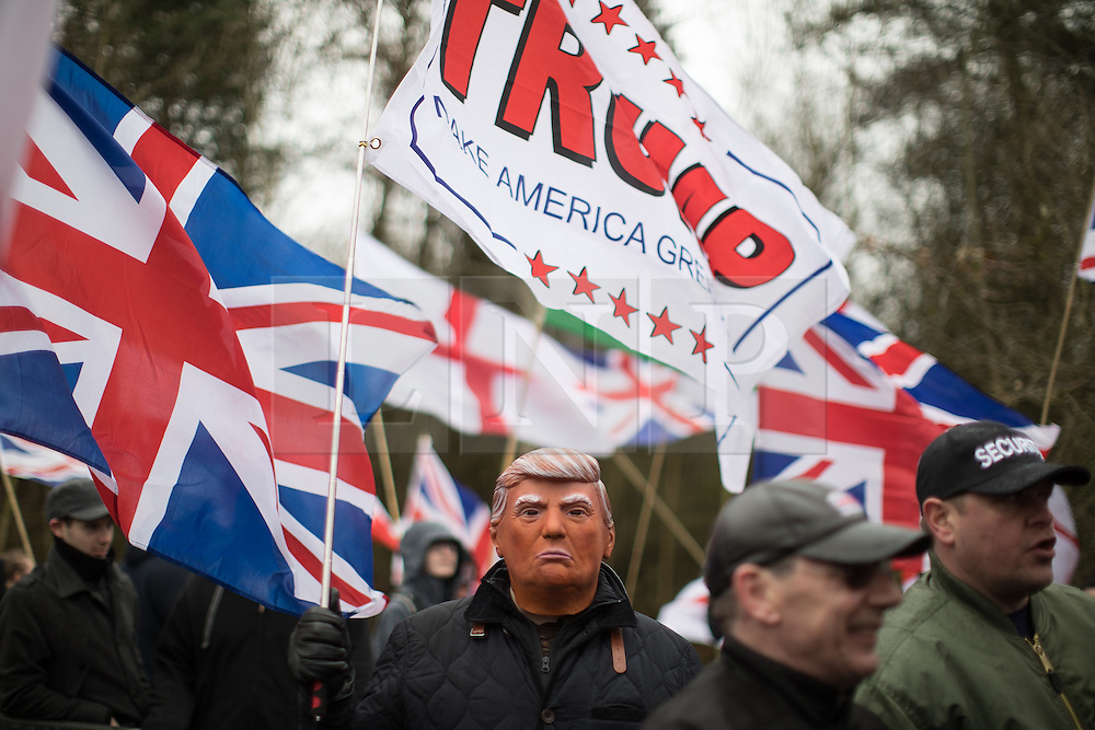 © Licensed to London News Pictures. 25/02/2017. Telford, UK. Man with Donald Trump mask at a Britain First demonstration in Telford , opposed by anti-fascist groups . Britain First say they are highlighting concerns about child sexual exploitation in the town . Photo credit: Joel Goodman/LNP