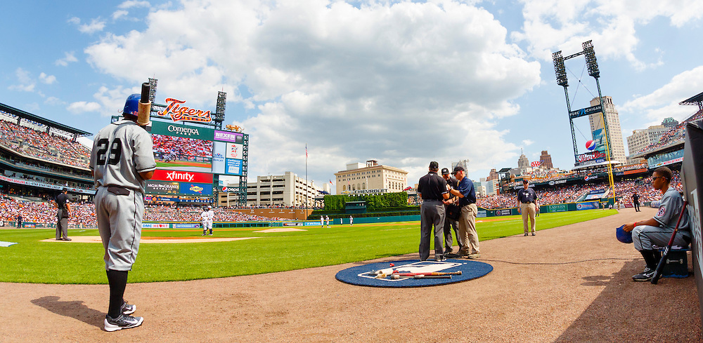 May 24, 2014; Detroit, MI, USA; Umpires (right) check with the review officials in New York during the first inning of the game between the Detroit Tigers and the Texas Rangers at Comerica Park. Mandatory Credit: Rick Osentoski-USA TODAY Sports