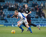 18th November 2017, Dens Park, Dundee, Scotland; Scottish Premier League football, Dundee versus Kilmarnock; Kilmarnock's Chris Burke battles for the ball with Dundee's Roarie Deacon