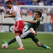 Armando, (left), New York Red Bulls, is challenged by Maximiliano Urruti, Portland Timbers, during the New York Red Bulls Vs Portland Timbers, Major League Soccer regular season match at Red Bull Arena, Harrison, New Jersey. USA. 24th May 2014. Photo Tim Clayton