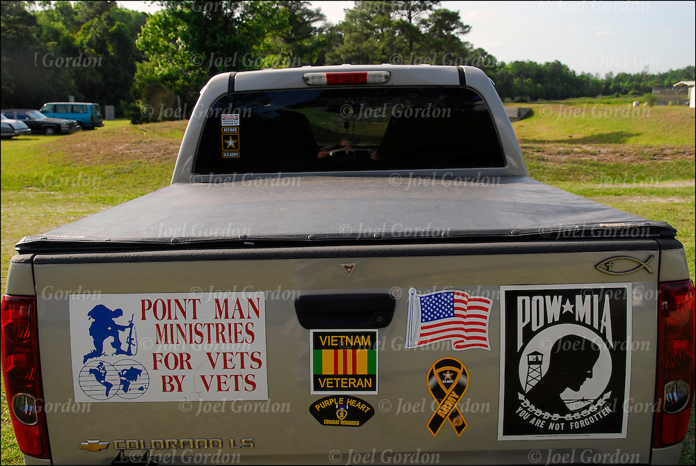 Five bumper stickers on back of pickup truck. <br />