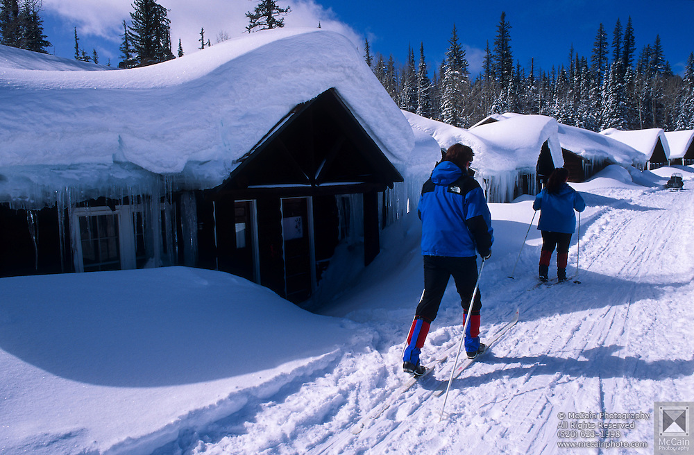 Guests skiing to cabins, Kaibab Lodge, North Rim Nordic Center, Grand Canyon National Park, Arizona..Media Usage:.Subject photograph(s) are copyrighted Edward McCain. All rights are reserved except those specifically granted by McCain Photography in writing...McCain Photography.211 S 4th Avenue.Tucson, AZ 85701-2103.(520) 623-1998.mobile: (520) 990-0999.fax: (520) 623-1190.http://www.mccainphoto.com.edward@mccainphoto.com