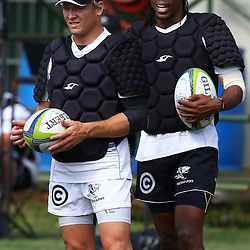 DURBAN, SOUTH AFRICA, 25 January 2016 -  Joe Pietersen with Odwa Ndungane during The Cell C Sharks Pre Season training for the 2016 Super Rugby Season at Growthpoint Kings Park in Durban, South Africa. (Photo by Steve Haag)<br /> images for social media must have consent from Steve Haag