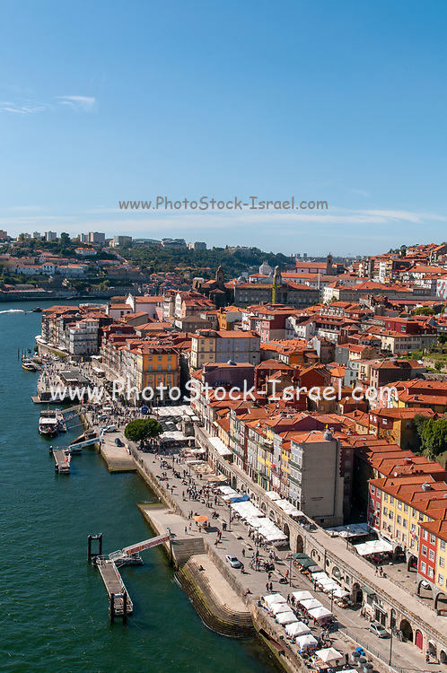 Porto cityscape and Douro river as seen from the top of Dom Luis I Bridge, Porto, Portugal looking west
