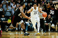 November 24th, 2013:  Colorado Buffaloes junior guard Spencer Dinwiddie (25) attempts to dribble the ball past Harvard Crimson junior guard/forward Wesley Saunders (23) in the second half of action in the NCAA Basketball game between the Harvard Crimson and the University of Colorado Buffaloes at the Coors Events Center in Boulder, Colorado