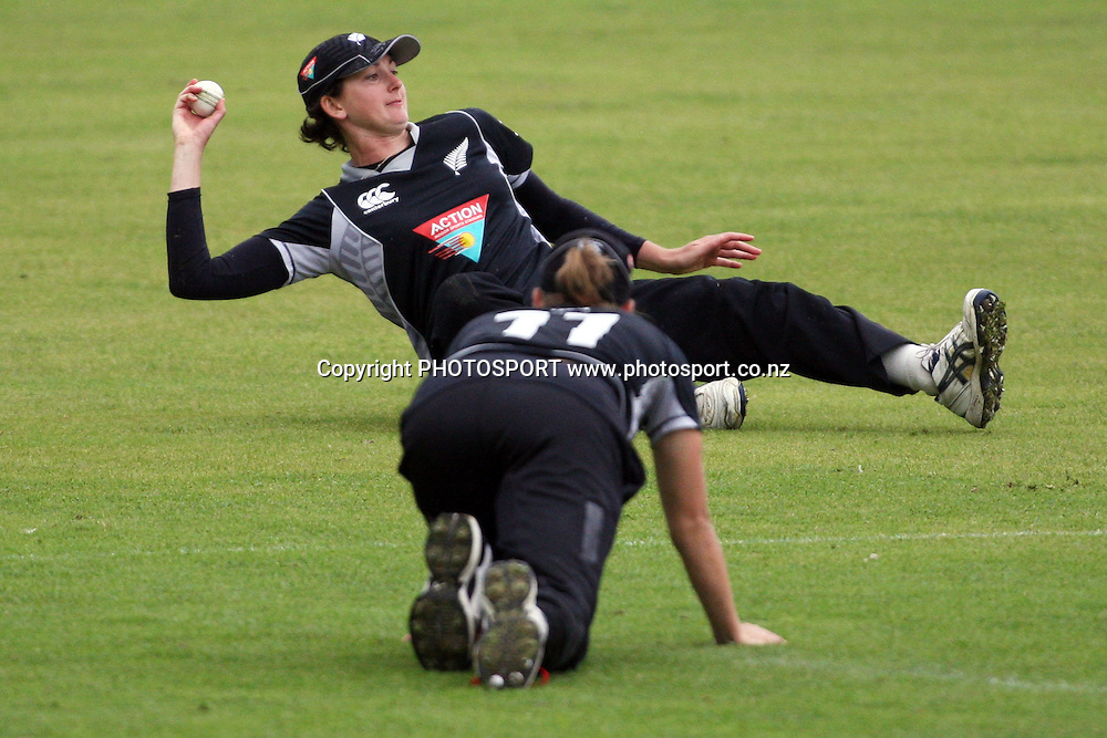 Nicola Browne fields the ball behind Sophie Devine, New Zealand White Ferns v Australia, Rosebowl cricket series, One day international, Queens Park, Invercargill. 7 March 2010. Photo: William Booth/PHOTOSPORT