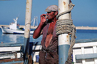 Alicante--- A fisherman takes a moment to smoke a cigarette. Spain. --- Image by © Owen Franken/CORBIS