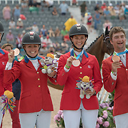 Silver Medal Canadian Eventing Team, Kathryn Robinson, Jessica Phoenix, Colleen Loach and Waylon Roberts on the podium at the OLG Caledon Pan Am Equestrian Park during the Toronto 2015 Pan American Games in Caledon, Ontario, Canada.