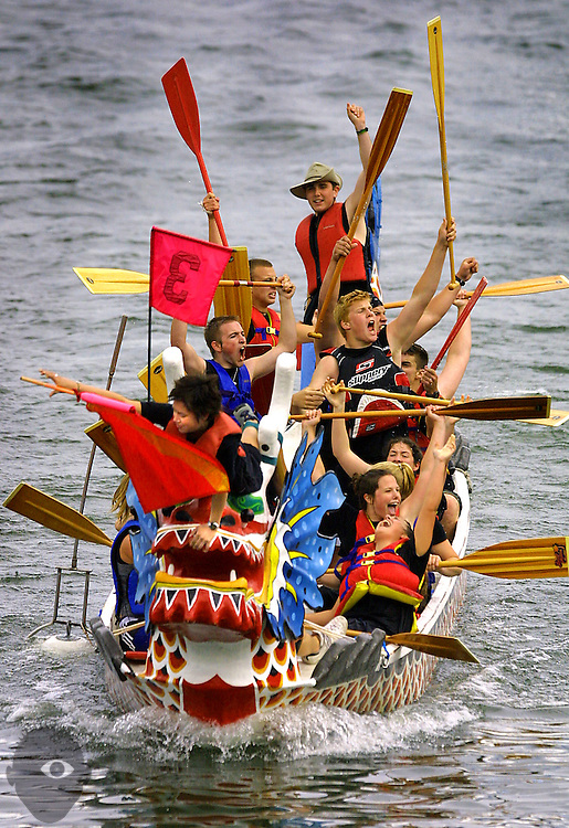 The Water Walkers from Cleveland High School are jubilant with their first place division finish in the finals of the dragon boat races on Sunday afternoon.