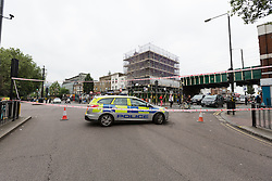 © Licensed to London News Pictures. 30/07/2016. LONDON, UK. Police cordon outside Bethnal Green tube station on Cambridge Heath Road, where a man in his 30's was stabbed and later died in hospital last night.  Photo credit: Vickie Flores/LNP