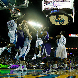 December 15, 2010; Sacramento Kings point guard Beno Udrih (19) shoots as New Orleans Hornets center Emeka Okafor (50) and power forward Jason Smith (14) andshooting guard Willie Green (33) during a game at the New Orleans Arena. The Hornets defeated the Kings 94-91. Mandatory Credit: Derick E. Hingle