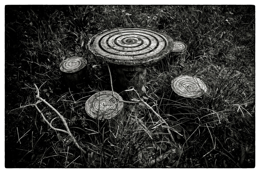 "Spiral motifs painted on concrete cast seating, in the grounds of the Pha Koeng Buddhist temple, Chaiyaphum Province, Northeast Thailand, 2016. From the series: Pha Koeng"" (2011-2017)."