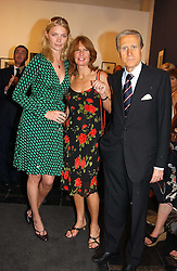Left to right, JODIE KIDD, the Italian ambassador GIANCARLO ARAGONA and his wife SANDRA ARAGONA at an exhibition of photographs featuring Maserati cars held at the Michael Hoppen Gallery, 3 Jubilee Place, London SW3 on 13th July 2005.<br /><br />NON EXCLUSIVE - WORLD RIGHTS