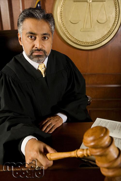 Middle-aged judge holding gavel