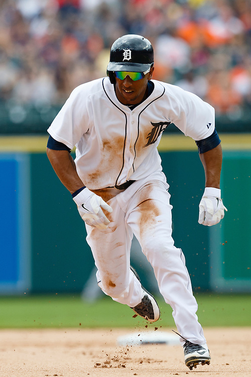 Jun 14, 2015; Detroit, MI, USA; Detroit Tigers center fielder Anthony Gose (12) runs to third in the first inning against the Cleveland Indians at Comerica Park. Mandatory Credit: Rick Osentoski-USA TODAY Sports