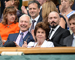 © Licensed to London News Pictures. 24/06/2014. London, UK . Wimbledon Tennis Championships 2014<br /> TV presenter John Humphrys with actor Hugh Jackman (moustache).  Photo credit : Mike King/LNP