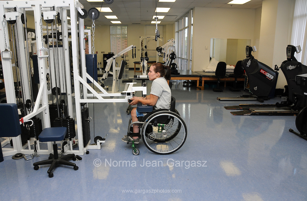 University of Arizona student Jennifer Poist works out at the campus Disability Resource Center.  Poist is on the university's wheelchair basketball team.
