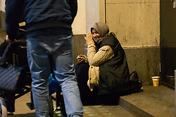 A woman rests on a side street just off Oxford Street. Homeless Britons are coming under increasing pressure as a surge of Roma beggars from Romania arrive on the streets of London to take advantage of the generosity of Christmas shoppers. London, December 04 2018.