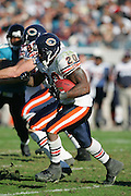 JACKSONVILLE, FL - DECEMBER 12:  Running back Thomas Jones #20 of the Chicago Bears looks for running room against the Jacksonville Jaguars but was limited to only 26 yards rushing on 13 carries on December 12, 2004 at Alltel Stadium in Jacksonville, Florida. The Jags defeated the Bears 22-3. ©Paul Anthony Spinelli *** Local Caption *** Thomas Jones