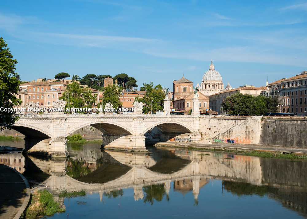 view of the River Tiber, the Ponte Vittorio Emanuele II and St. Peter's Basilica in Vatican City Rome , Italy