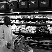 Havyalimana Jean-de Dieu, a Burundian refugee, gets overwhelmed seeing a massive Walmart food aisle during his first grocery trip of his life.