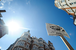 © Licensed to London News Pictures. 18/08/2012. London,UK. A placard is pictured outside the Ecuadorian Embassy in London on August 18, 2012, after WikiLeaks founder Julian Assange was granted asylum by the Ecuadorian Government . Photo credit : Thomas Campean/LNP