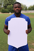 AFC Wimbledon defender Deji Oshilaja (4) holding Fifa sign during the AFC Wimbledon 2018/19 official photocall at the Kings Sports Ground, New Malden, United Kingdom on 31 July 2018. Picture by Matthew Redman.