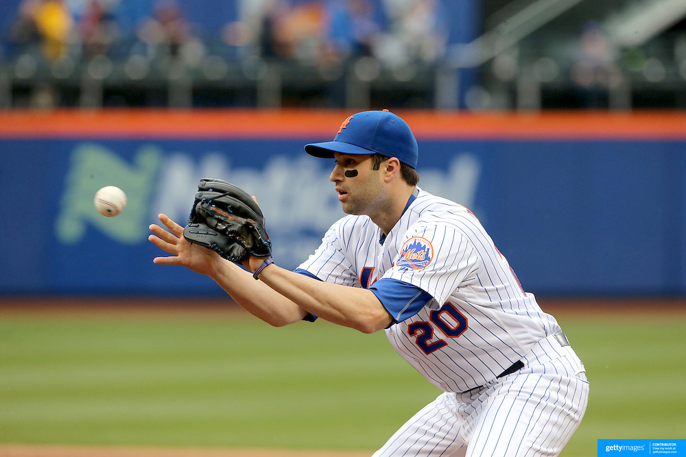 NEW YORK, NEW YORK - May 21:  Neil Walker #20 of the New York Mets covers first base for the out during the Milwaukee Brewers Vs New York Mets regular season MLB game at Citi Field on May 21, 2016 in New York City. (Photo by Tim Clayton/Corbis via Getty Images)