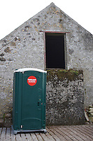 Portable toilet in farmyard at music festival in County Westmenth in Ireland