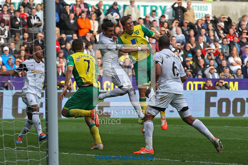 Ryan Bennett of Norwich heads for goal during the Barclays Premier League match at the Liberty Stadium, Swansea<br /> Picture by Paul Chesterton/Focus Images Ltd +44 7904 640267<br /> 29/03/2014