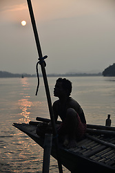 October 2, 2018 - Guwahati, Assam, India - Fisherman taking rest in a boat after fishing, in the bank of Brahmaputra river in Guwahati, Assam, India on Tuesday, 2 October 2018. (Credit Image: © David Talukdar/NurPhoto/ZUMA Press)