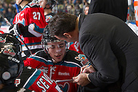 KELOWNA, CANADA - NOVEMBER 30:  Jesse Lees #2 of the Kelowna Rockets listens to coach Dan Lambert discuss a play against the Moose Jaw Warriors at the Kelowna Rockets on November 30, 2012 at Prospera Place in Kelowna, British Columbia, Canada (Photo by Marissa Baecker/Getty Images) *** Local Caption ***