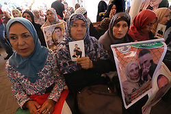 July 3, 2017 - Gaza City, Gaza Strip, Palestinian Territory - Palestinians take part in a protest to show solidarity with Palestinian prisoners held in Israeli jails, in front of Red cross office in Gaza city on July 3, 2017  (Credit Image: © Mohammed Asad/APA Images via ZUMA Wire)