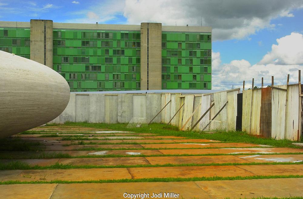 A green building a rock orb in Brasilia, Brazil