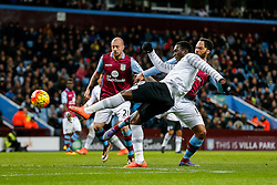 Romelu Lukaku of Everton shoots as Joleon Lescott of Aston Villa chllenges - Mandatory byline: Rogan Thomson/JMP - 01/03/2016 - FOOTBALL - Villa Park Stadium - Birmingham, England - Aston Villa v Everton - Barclays Premier League.