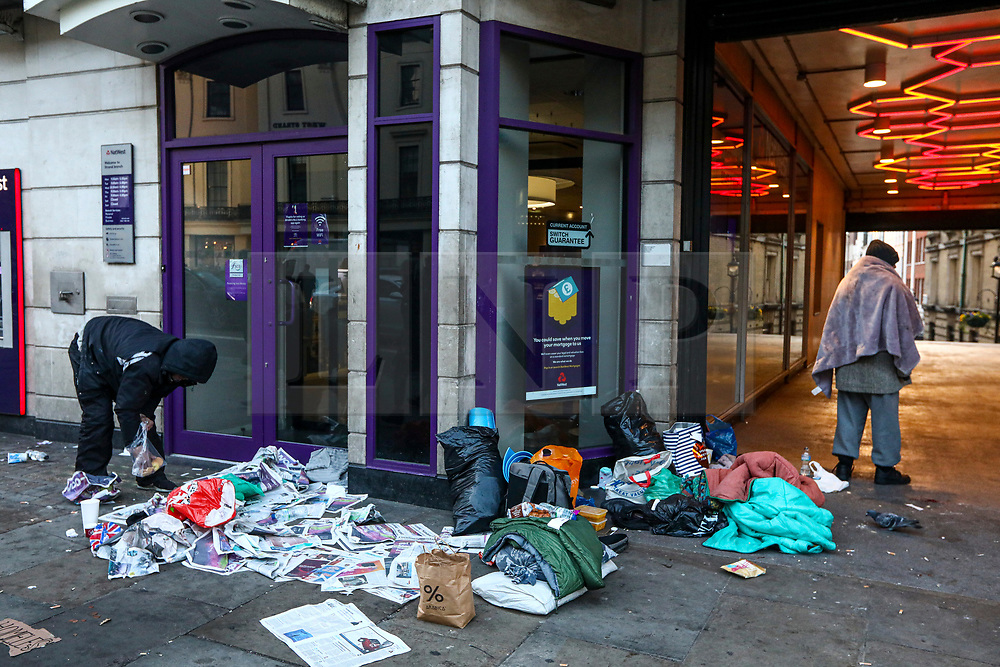 FILE IMAGE © Licensed to London News Pictures. 19/11/2019. London, UK.Two homeless men arrange their makeshift home clearing up newspaper they use for insulation against the cold pavement in Buckingham Arcade in the Strand.  Pictures highlight the reality of homelessness in Westminster taken during the build up of Brexit and the General election just a few hundreds yards from Parliament and Downing Street. Photo credit: Alex Lentati/LNP