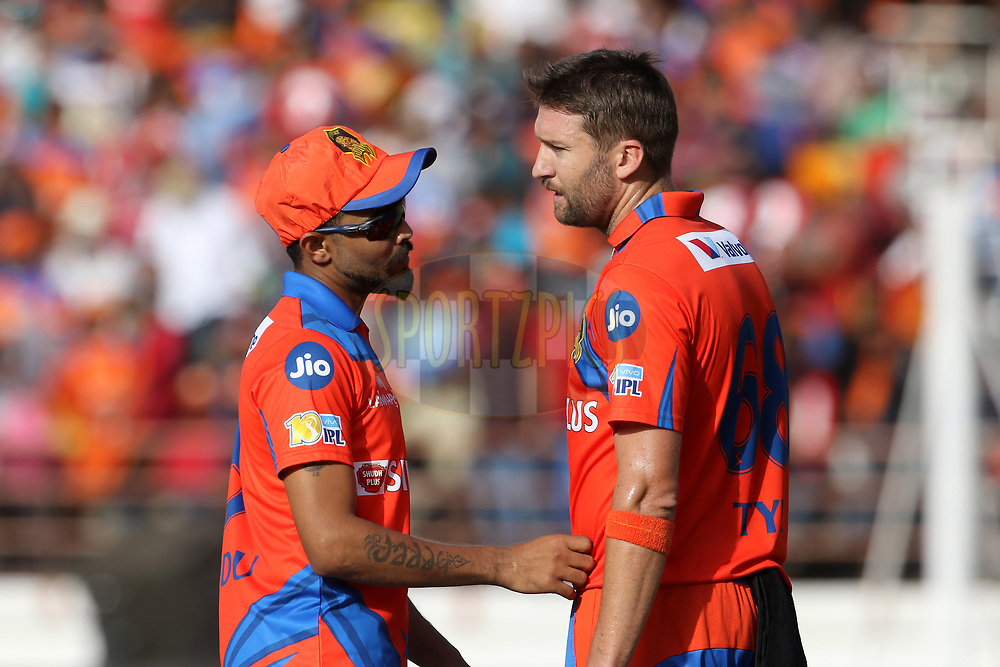 Andrew Tye of the Gujarat Lions and Ravindra Jadeja of the Gujarat Lions during match 26 of the Vivo 2017 Indian Premier League between the Gujarat Lions and the Kings XI Punjab held at the Saurashtra Cricket Association Stadium in Rajkot, India on the 23rd April 2017<br /> <br /> Photo by Vipin Pawar - Sportzpics - IPL