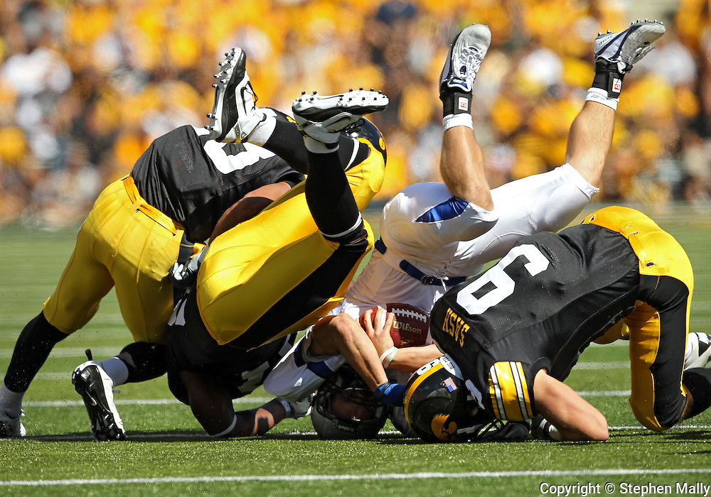 September 4 2010: Eastern Illinois Panthers running back Jimmy Potempa (2) is hit by Iowa Hawkeyes cornerback Micah Hyde (18), Iowa Hawkeyes linebacker Bruce Davis (57), and Iowa Hawkeyes cornerback Tyler Sash (9) during the first quarter of the NCAA football game between the Eastern Illinois Panthers and the Iowa Hawkeyes at Kinnick Stadium in Iowa City, Iowa on Saturday September 4, 2010. Iowa defeated Eastern Illinois 37-7.