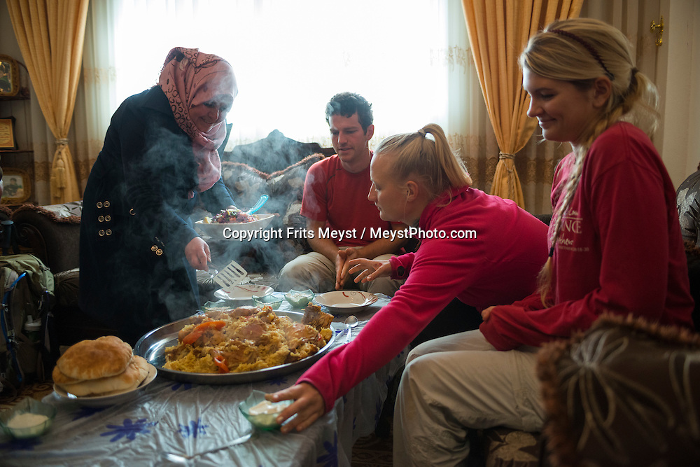 Akraba, Palestine, March 2015. Homestay and lunch with a Palestinian family in Akraba. The Abraham Path is a long-distance walking trail across the Middle East which connects the sites visited by the patriarch Abraham. The trail passes through sites of Abrahamic history, varied landscapes, and a myriad of communities of different faiths and cultures, which reflect the rich diversity of the Middle East. Photo by Frits Meyst / MeystPhoto.com for AbrahamPath.org