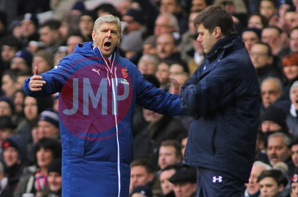 Arsenal Manager, Arsene Wenger reacts as Tottenham Hotspur Manager, Mauricio Pochettino looks on - Photo mandatory by-line: Mitchell Gunn/JMP - Mobile: 07966 386802 - 07/02/2015 - SPORT - Football - London - White Hart Lane - Tottenham Hotspur v Arsenal - Barclays Premier League