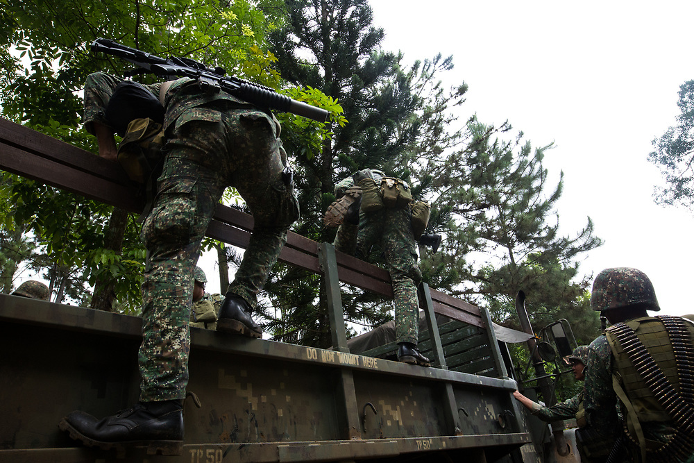 MARAWI, PHILIPPINES - JUNE 9: Philippine marines gets on to the truck as they prepare to attack the Islamist rebels in Marawi, southern Philippines on June 9, 2017. Philippine military jets fired rockets at militant positions on Friday as soldiers fought to wrest control of the southern city from gunmen linked to the Islamic State group. (Photo: Richard Atrero de Guzman/NUR Photo)