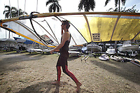 Olympic windsurfer from Chicago, is getting ready his windsurfing board before his training session in Miami on Saturday January 14, 2012. Willis has taken up windsurfing and will representing the U.S. at the London Games.  Photo/ Cristobal Herrera