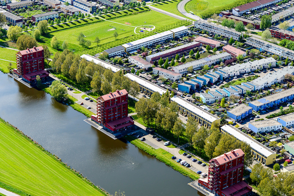 Nederland, Flevoland, Almere, 07-05-2015; Almere-Buiten, Regenboogbuurt met aan het water van de Lage Vaart de Rooie Donders van architect Liesbeth van der Pol. Residential distict 'Rainbow Area'. Next to the canal Lage Vaart some red buildings called Rooie Donders (red devils) by architect Liesbeth van der Pol.<br /> <br /> luchtfoto (toeslag op standard tarieven);<br /> aerial photo (additional fee required);<br /> copyright foto/photo Siebe Swart