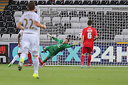 goalkeeper Scott Flinders saves again during the Capital One Cup match between Swansea City and York City at the Liberty Stadium, Swansea, Wales on 25 August 2015. Photo by Simon Davies.