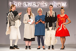 © Licensed to London News Pictures. 03/06/2014. London, England. Rebecca Swann from Nottingham Trent University receives the Stuart Peters Knitwear Award. Graduate Fashion Week 2014 concludes with the awards show at the Old Truman Brewery in London, United Kingdom. Photo credit: Bettina Strenske/LNP