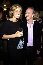 MR & MRS SIMON SEBAG-MONTEFIORE, she was Santa Palmer-Tomkinson a family friend of the Prince of Wales, at a party in London on 19th September 2000.OHC 33